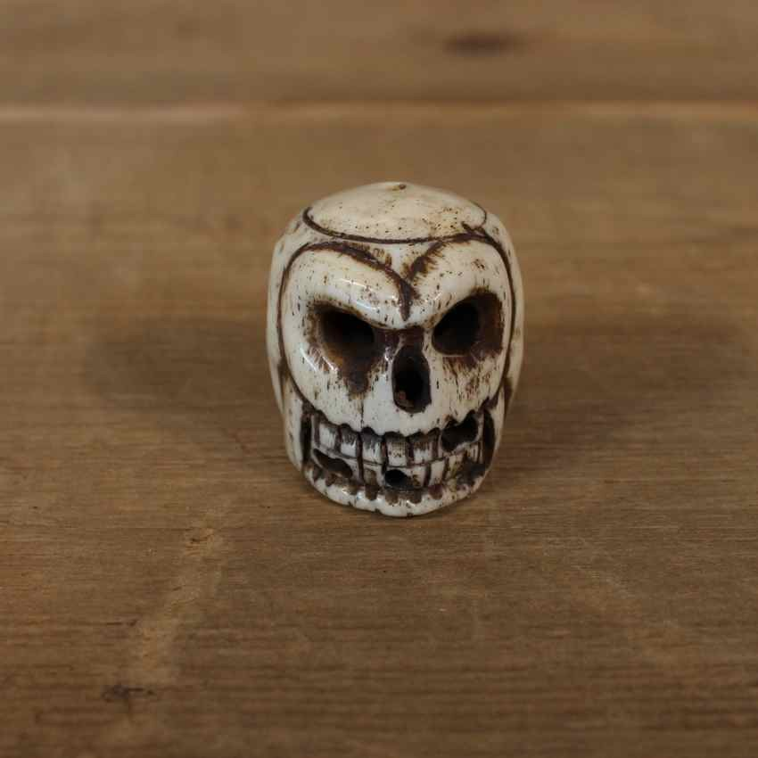 Native ivory carved skull figurine for sale the